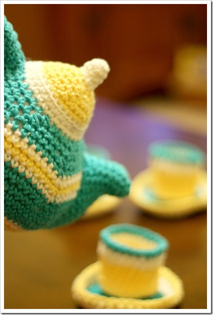 crocheted tea pot pouring pretend tea