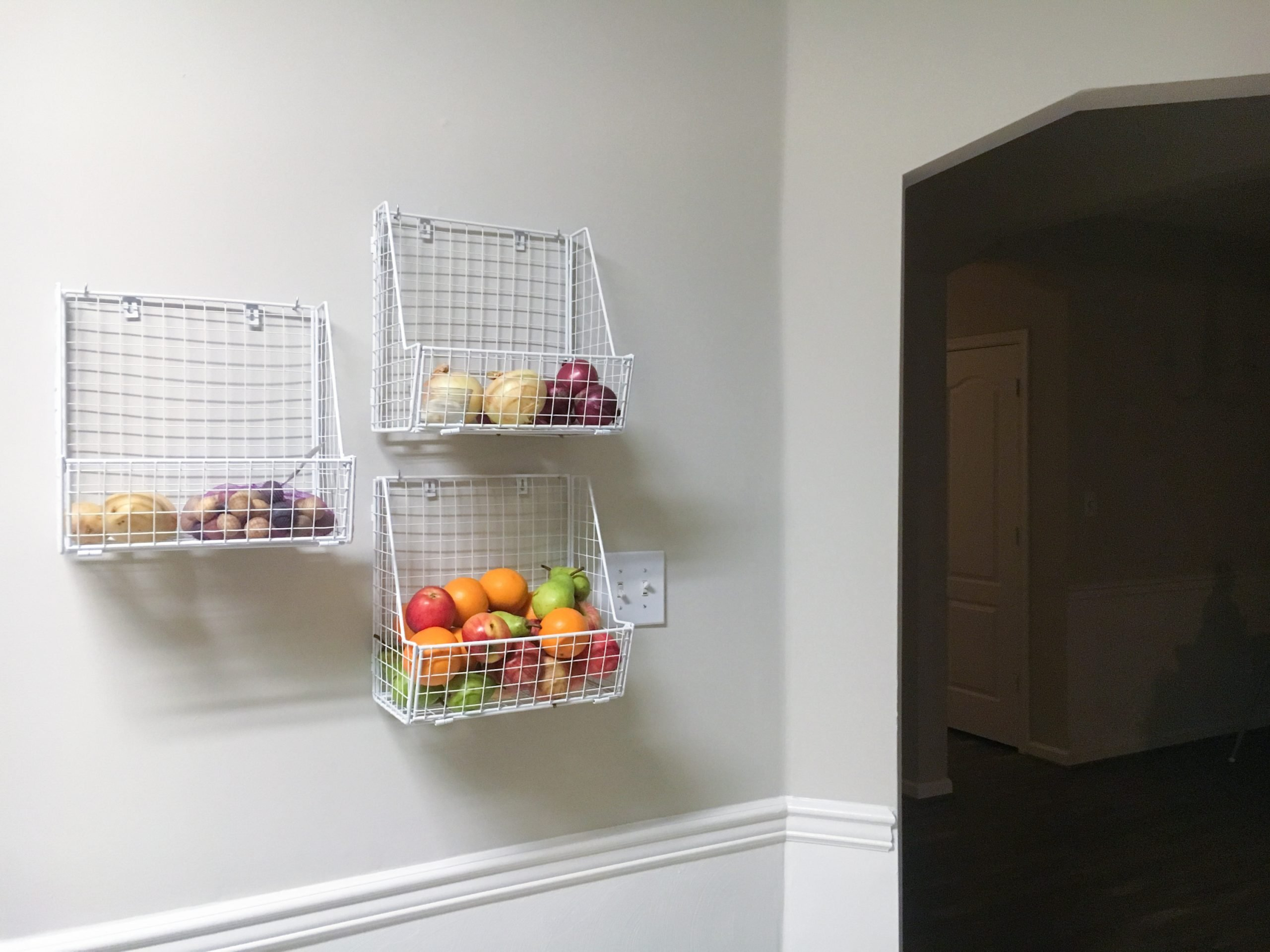 fruit baskets mounted on the wall