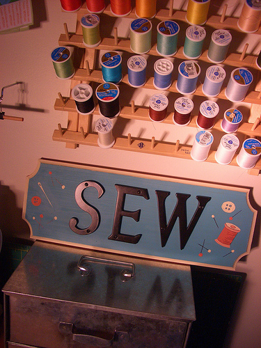 sewing room plaque with hardware store materials