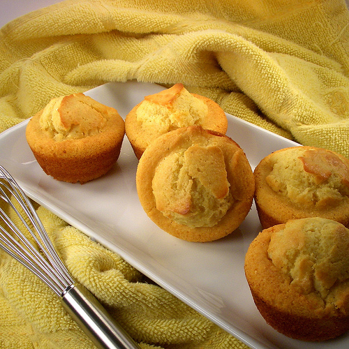 honey cornbread muffins made with bacon grease on a yellow towel