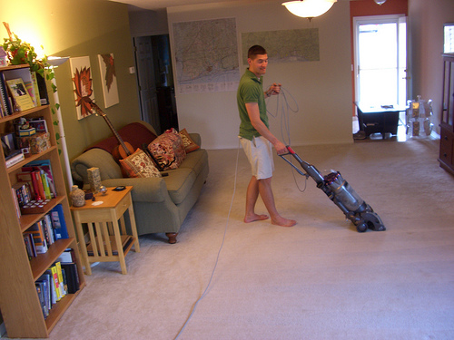 husband vacuuming doing chores