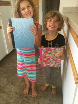 kids with composition notebooks