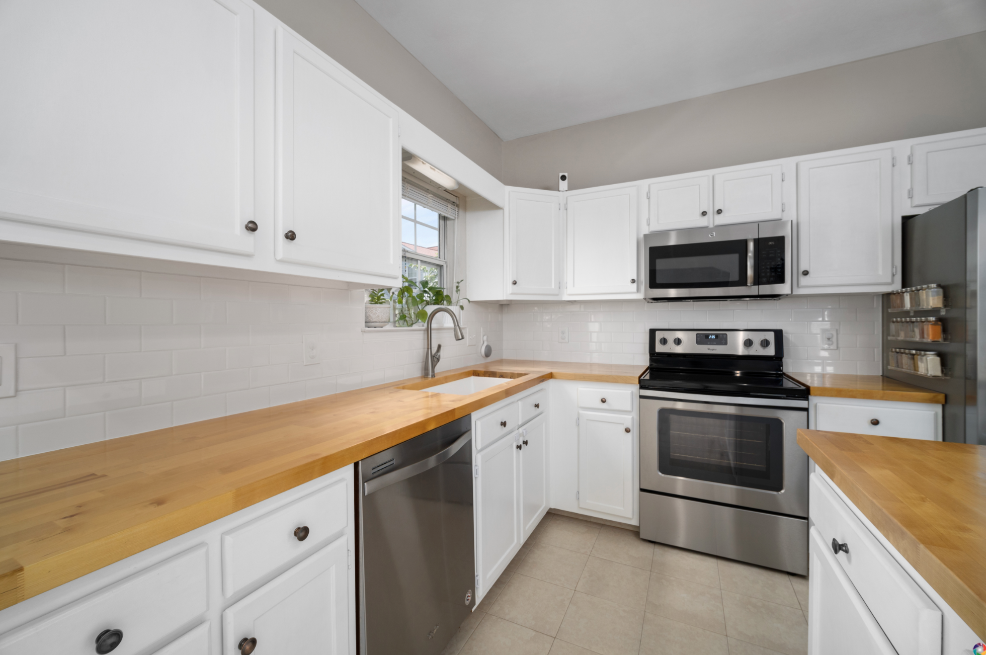 bright and airy kitchen remodel - white cabinets and butcher block counters with subway tile backsplash