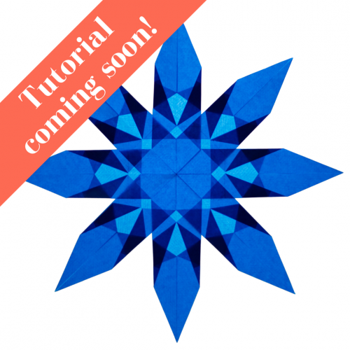 blue 8 pointed paper window star that looks like a quilt block