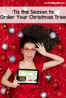 Surprised Christmas Girl with Tablet
