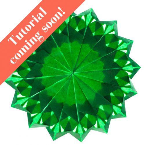 dark green 16 pointed folded paper window star suncatcher