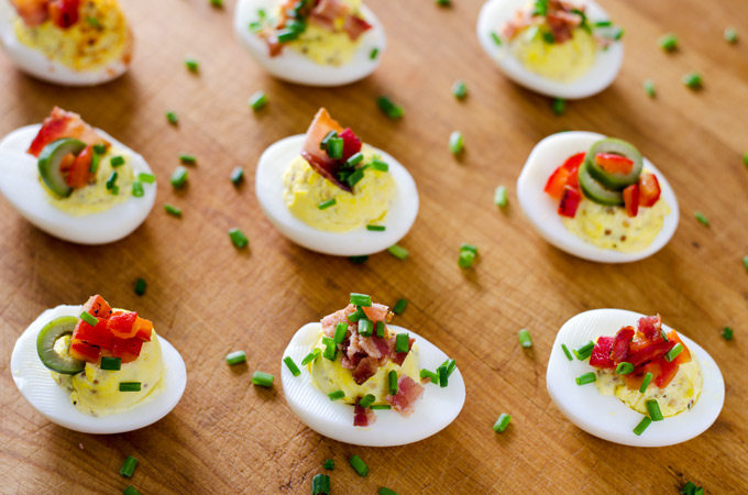Dijon mustard, garlic oil, bacon, and chives. Sounds like some delicious deviled eggs to me!