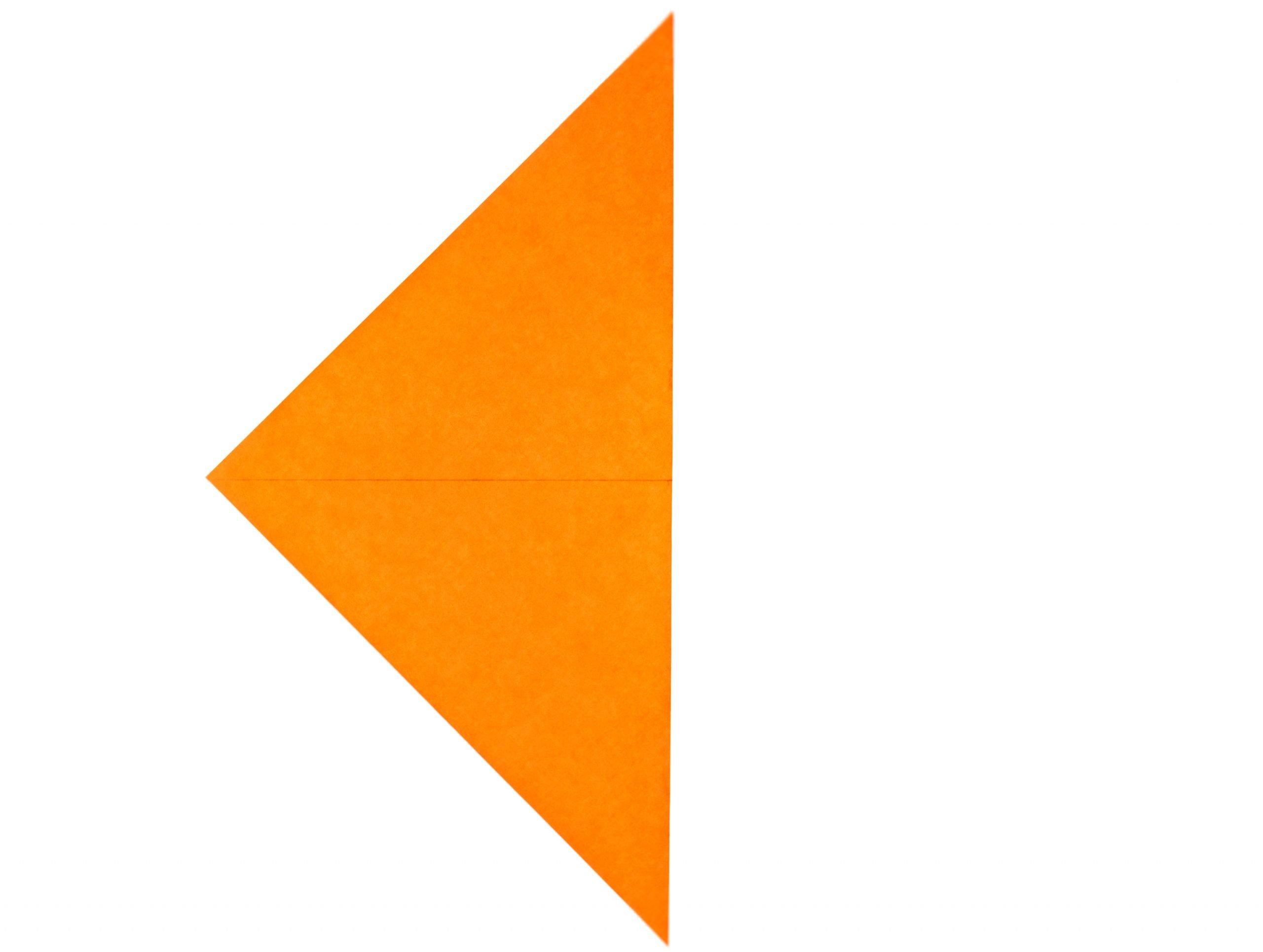 orange origami paper square folded in half diagonally