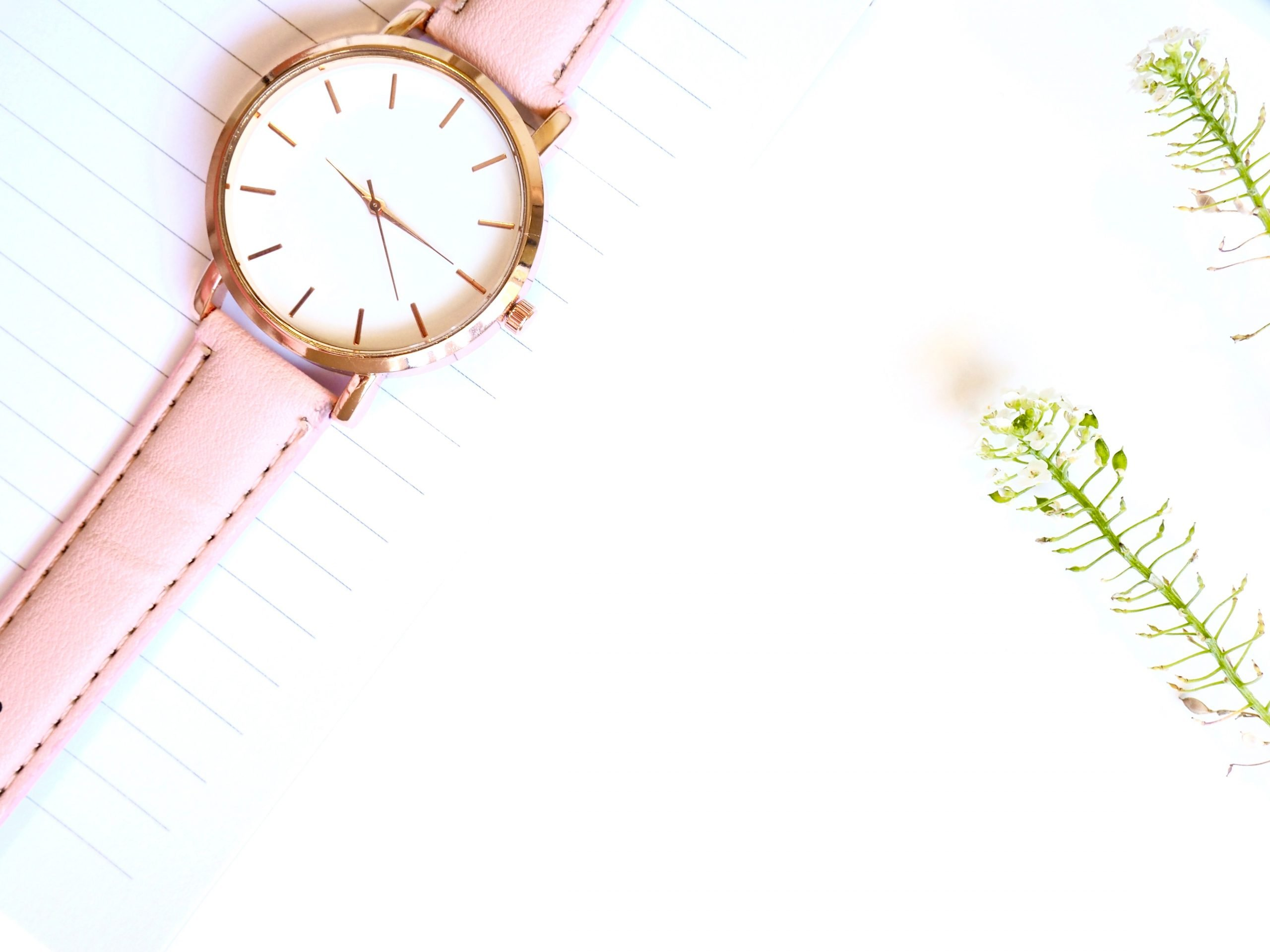 pink watch on a piece of notebook paper