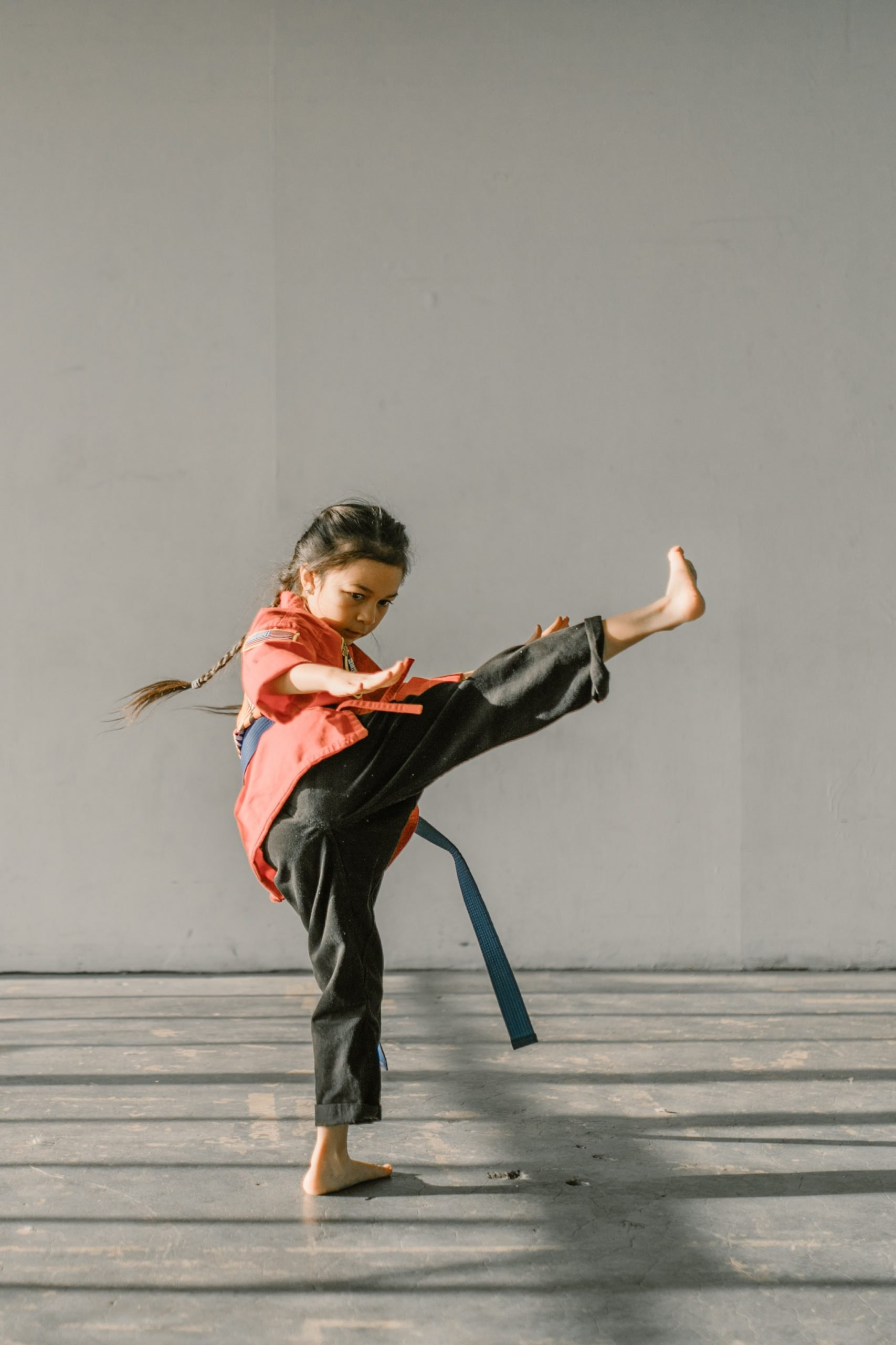 child doing martial arts.