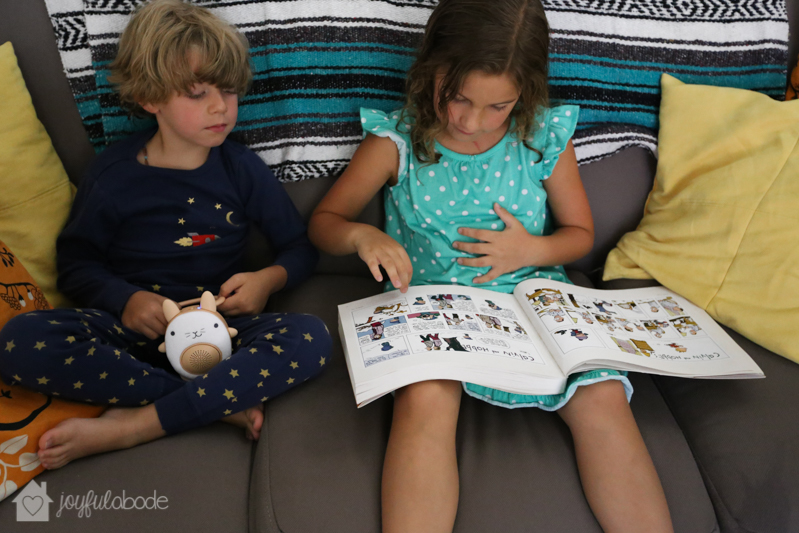 kids reading and listening to soft music on their portable bluetooth speaker for children - soundbub by wavhello