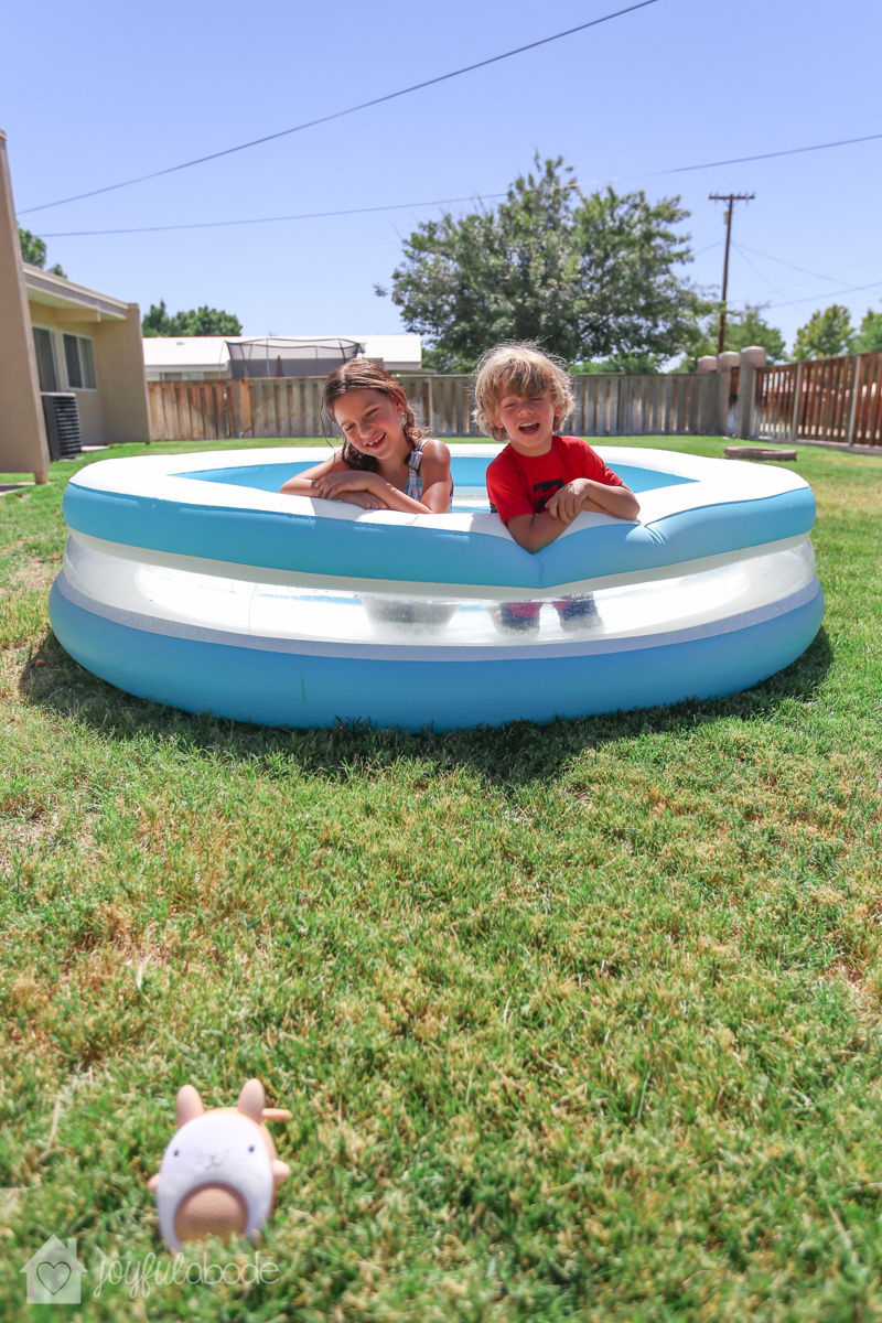 kids playing in their pool, listening to music on their soundbub bella the bunny bluetooth speaker