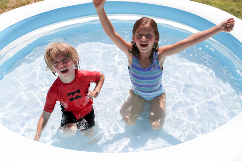 kids playing in their pool outside