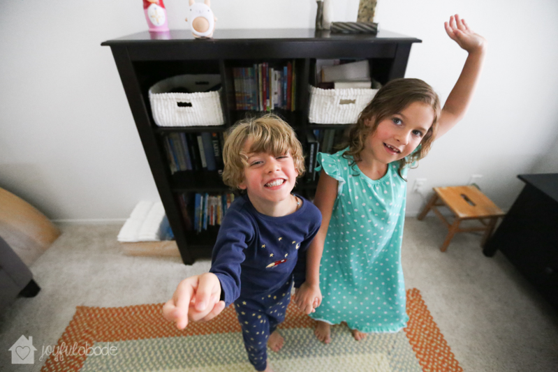 kids having a dance party in the living room, listening to music on their wavhello bluetooth speaker
