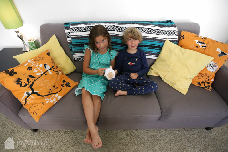 kids enjoying some quiet music on the couch with their soundbub bella the bunny bluetooth speaker
