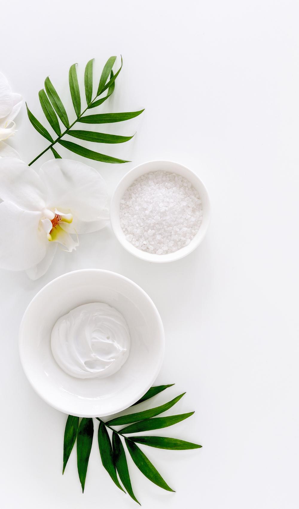 spa flatlay with bath salt and plants