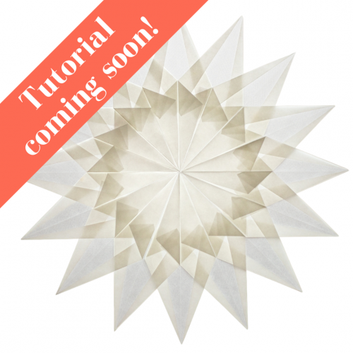 16 pointed white folded paper window star or snowflake